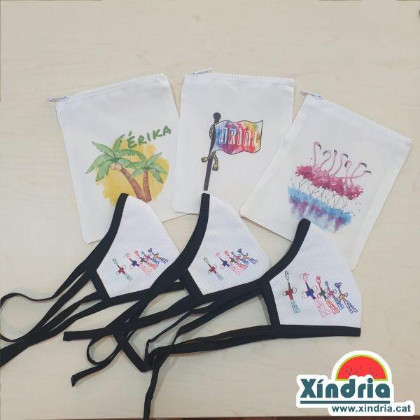 Mascaretes personalitzades amb els dibuixos dels nens i nenes i bossa per portar-les.